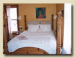 Photo of bed at Minden bed and breakfast